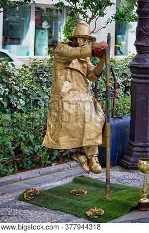 Granada, Spain - September 05, 2015: A Street Performer In Disguise Performing Levitation Trick