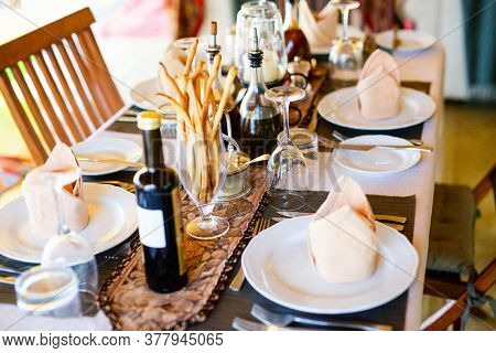 Table setting for romantic lunch or dinner in a dining room in luxury safary lodge
