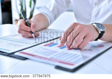 Businessman Working In Office And Analyzing Financial Results. Finance And Trade Concept.