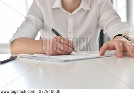 Stock Broker Analyzing Financial Report And Stock Statistics In Office. Business And Financial Succe