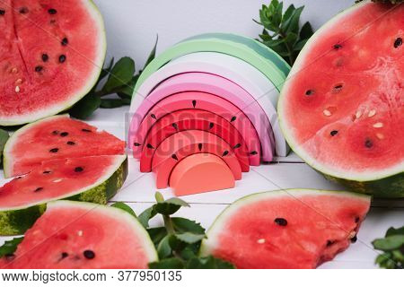 Bright Watermelon Is Made Of Wood. Natural Watermelon And Toy Watermelon. Toy Rainbow Made Of Natura