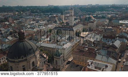 Aerial Drone Shot Of City Lviv, Ukraine. Flight Over Roofs, Streets. Panorama Of Popular Central Par