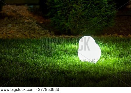 Backyard Garden Light With Lantern Electric Lamp With Sphere Diffuser In Green Grass With Thuja Bush