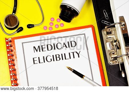 Eligibility For Medicaid - Text Inscription On The Form On The Medical Folder. A Federal-state Healt