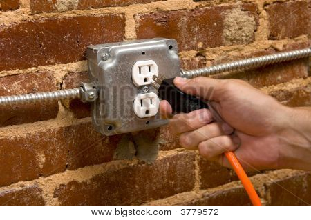 Plugging In An Extension Cord