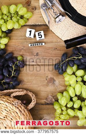Grapes, Bottle Of Wine, Glass With Wine, Hat On A Wooden Background. View From Above. Winemaking And