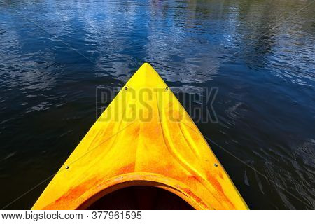 Close Up Shot Of A Tip Of Canoe In The River On A Sunny Day. Exploring Nature On Water.