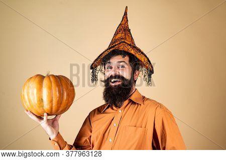 Happy Halloween Stickers. Handsome Halloween Man With Pumpkin In Hand. Bearded Man Cook In Halloween