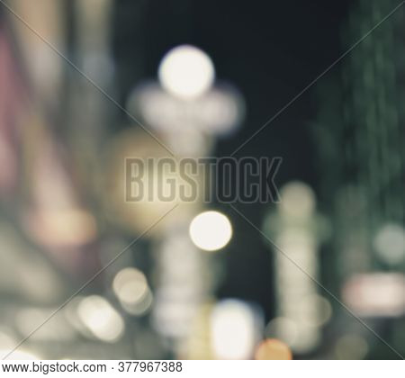 Abstract Blur Image Of Colorful Night Light City Tower Background