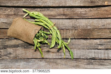 Yardlong Bean Or Pea Bean Isolated On Wooden Background, Also Known As Asparagus Bean