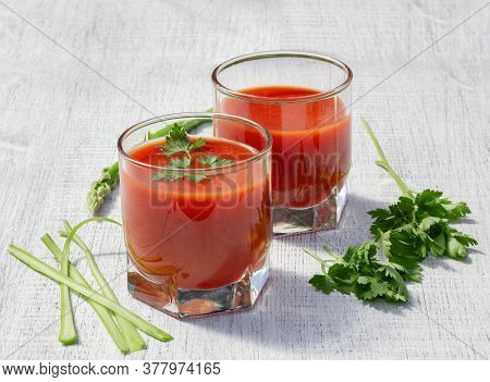 Glasses Are Filled With Tomato Juice With Parsley And Celery