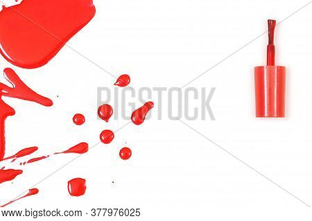 Bottle With Nail Polish Dropped, Varnish Spilled, Varnish Splashes Isolated On White Background