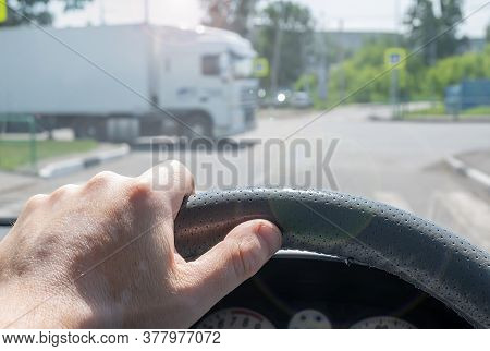View Of The Driver Hand At The Wheel Of A Car At A Road Intersection That Gives Way To A Cargo Van P