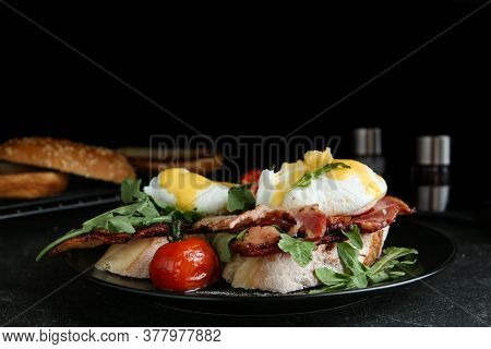 Delicious Eggs Benedict Served On Black Table