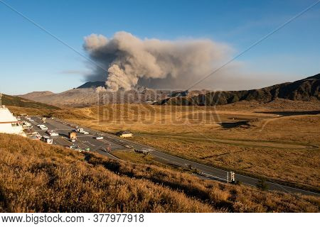 Landscape View Of Mount Aso (largest Active Volcano In Japan) Venting Ashes And Aso-kuju Valley With