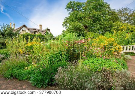 London, Uk - August 24, 2019 - Thatched House Royal Residence In The Grounds Of Pembroke Lodge, Rich