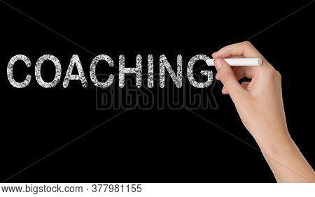 Business Or Life Trainer Writing Word Coaching On Blackboard, Closeup