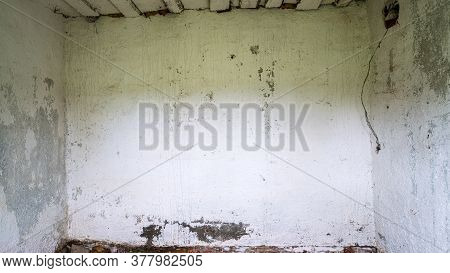 Abandoned Former Shed Building Inner Premise With Dirty Grey Peeling Walls And Ceiling At Sunlight C