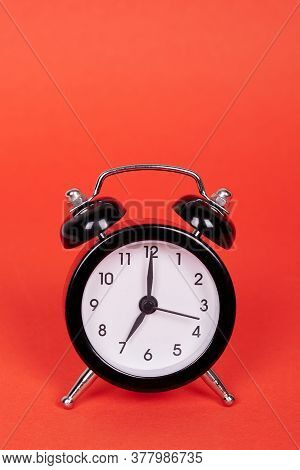 Classic Analog Clock With Bells. Isolated On Red Background. Copy Space.