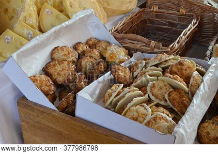 Group Of Many White Chocolate Candies With Dried Fruits And Nuts Displayed For Sale At Naschmarkt A