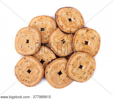 Group of round cookies with hole, chocolate bottom, seeds of poppy. Isolated on white background