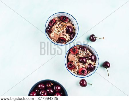 Chocolate Ice Cream Sundae Bowls With Cherries, Almond And Chocolate Sprinkles On Green Turquoise Ba