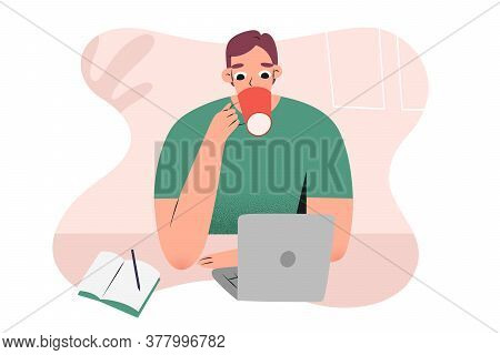 Young Man Working From Home Or Cafe With Notebook, Laptop, Drinking His Coffee, Making Notes Sitting