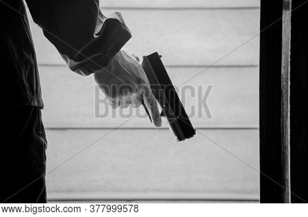Killer With Gun Close Up Over Stair Background With Copyspace.