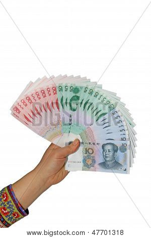 A Person's Hand Who Holds A Pile Of Money