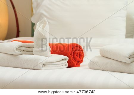 Towels on bed at luxury hotel room