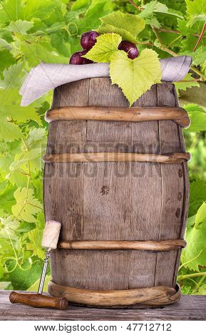 Grapes On A Wooden Vintage Barrel With Corkscrew
