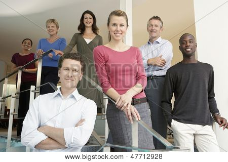 Group portrait of multiethnic business people standing in office