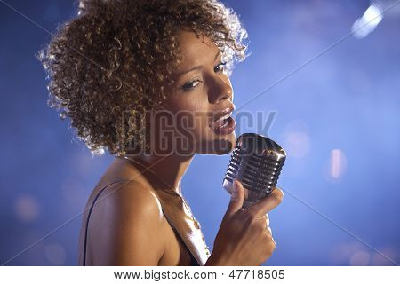 Closeup of a female jazz singer on stage