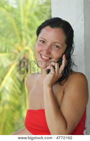 Smiling Beautiful Young Woman With Cellphone