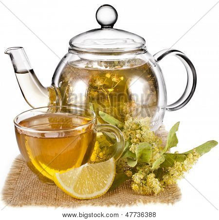 Tea pot with glass tea cup and linden bloom  isolated on white background