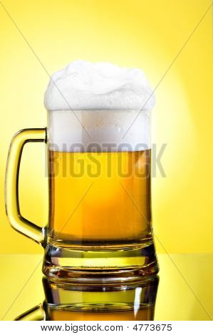 Full mug of lager beer on yellow background poster