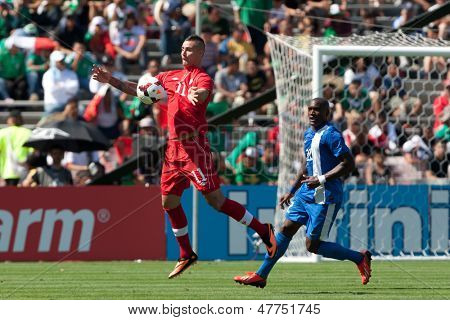 PASADENA, CA - JULY 7: Marcus Haber #11 of Canada in action during the 2013 CONCACAF Gold Cup game between Canada and Martinique on July 7, 2013 at the Rose Bowl in Pasadena, Ca.