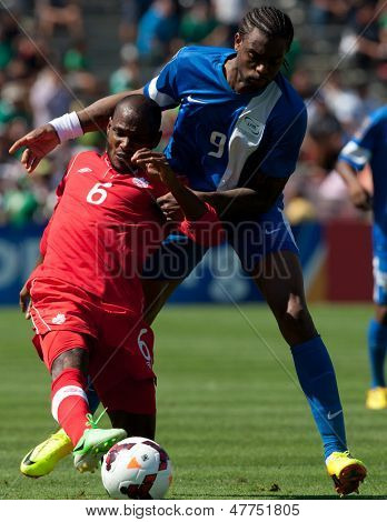 PASADENA, CA - JULY 7: Julian De Guzman #6 of Canada and Frederic Piquionne #9 of Martinique during the 2013 CONCACAF Gold Cup game between Canada and Martinique on July 7, 2013 at the Rose Bowl.