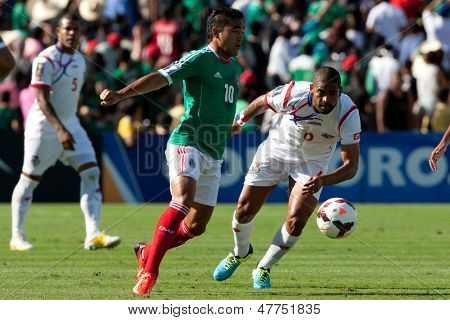 PASADENA, CA - JULY 7: Marco Fabian #10 of Mexico and Gabriel Gomez #6 of Panama during the 2013 CONCACAF Gold Cup game between Mexico and Panama on July 7, 2013 at the Rose Bowl in Pasadena, Ca.