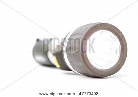 Shiny light torch isolated on white
