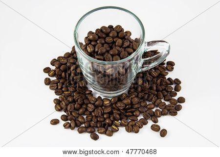 Coffee Beans With Glass On White Background