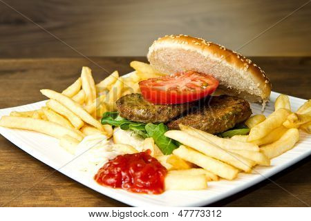 hamburger bun with fries