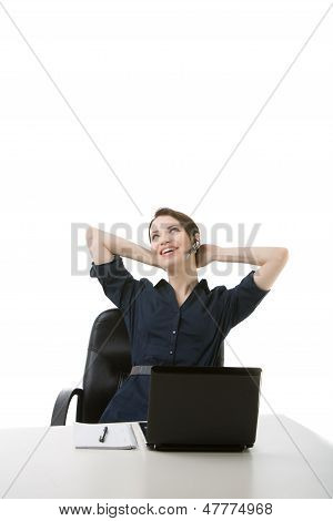 Successful Businesswoman Relaxing At Her Desk