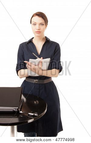 Beautiful Woman Writing Notes In A Notebook