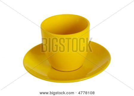 Yellow Tea Cup And Saucer On White Background.