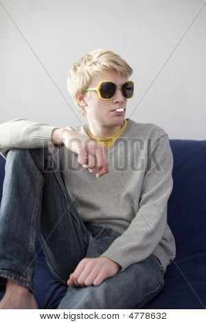 Portrait Of Young Blond Funny Man Smoking Cigarette
