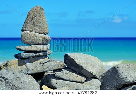 closeup of a stack of stones on a tropical beach