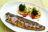 Saba Fish Steak with vegetable on white plate. poster