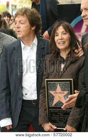 Sir Paul McCartney and Olivia Harrison at the ceremony posthumously honoring George Harrison with a star on the Hollywood Walk of Fame. Vine Boulevard, Hollywood, CA. 04-14-09
