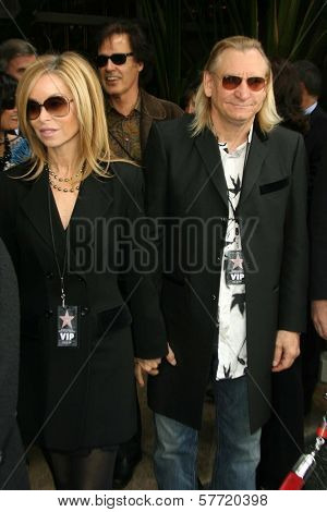 Marjorie Bach and Joe Walsh at the ceremony posthumously honoring George Harrison with a star on the Hollywood Walk of Fame. Vine Boulevard, Hollywood, CA. 04-14-09